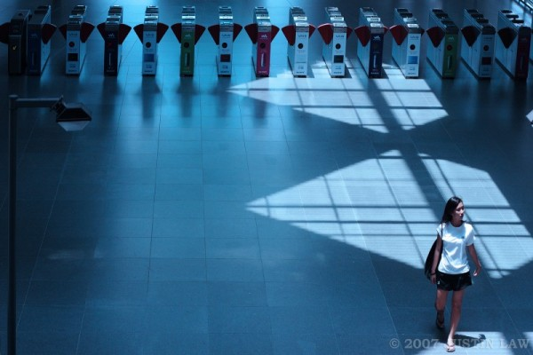 Girl walking through train station in blue