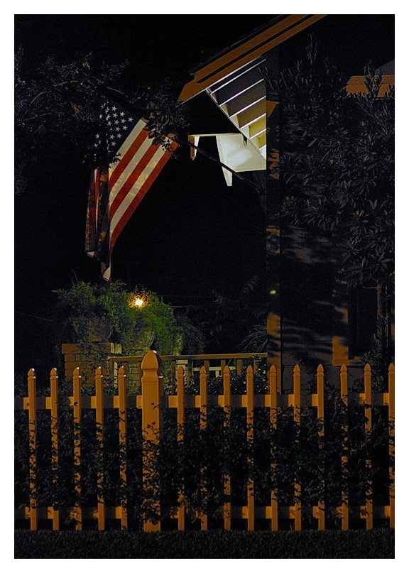 Night picket fence with American flag