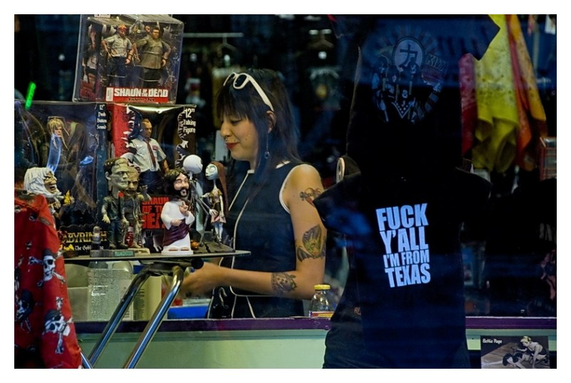 Tatooed clerk on 6th Street