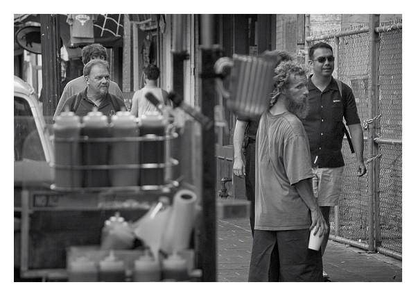 Homeless man and hotdog stand, 6th Street, Austin
