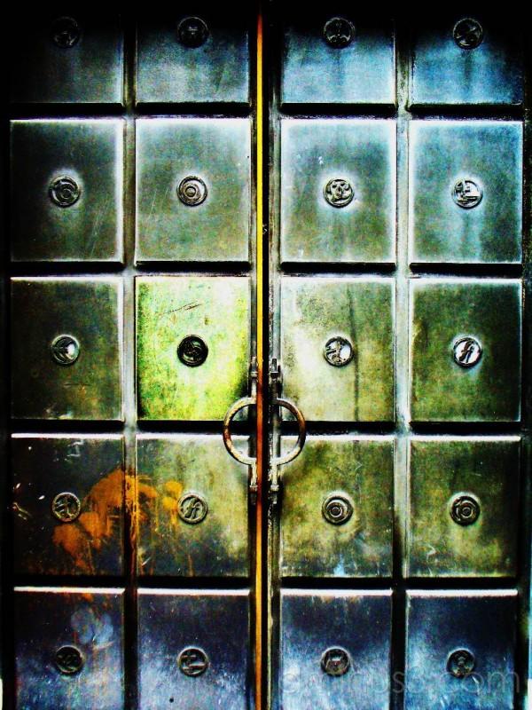 Metal door with currenty symbols