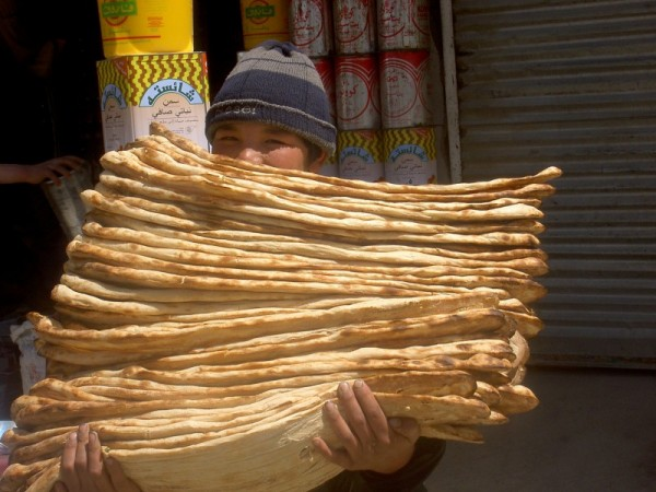 boy from Kabul holding bread