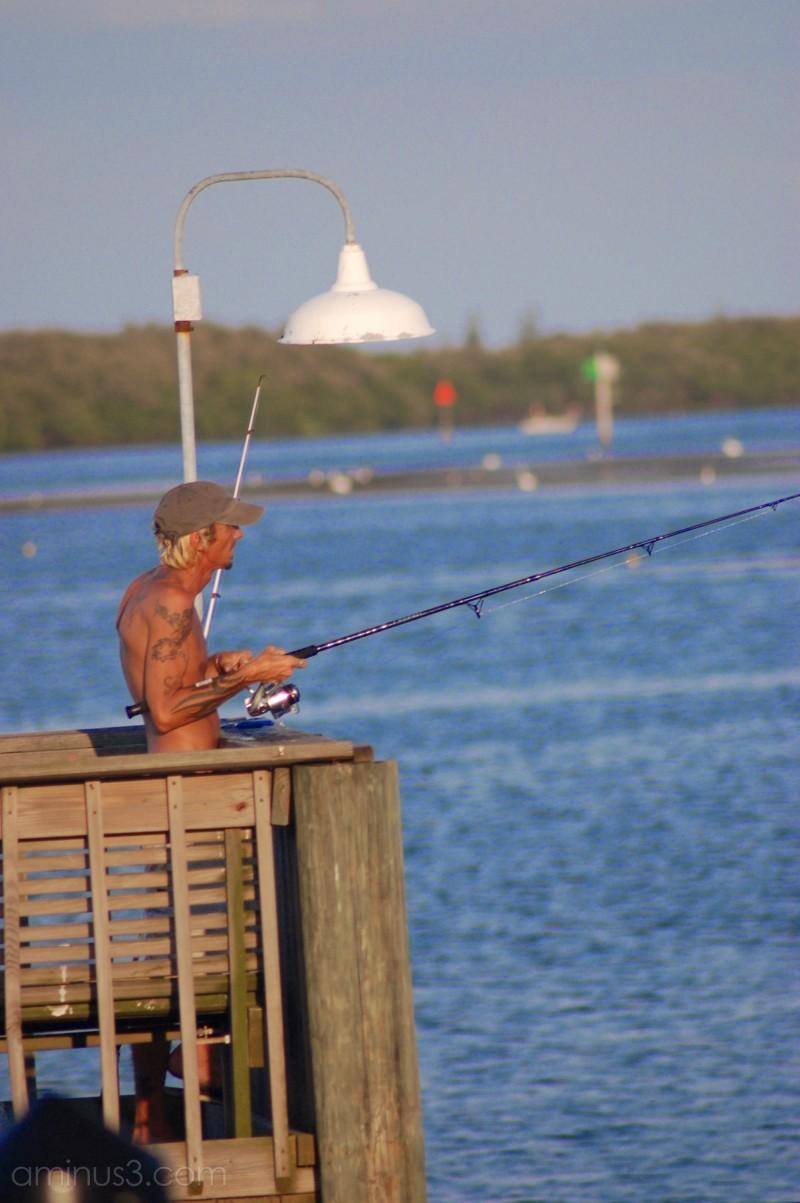 Man fishing with tattoos at Long Boat Key