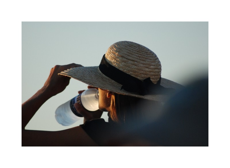 Girl in hat drinking water CapeCod