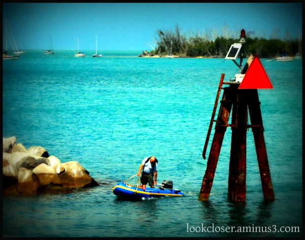 blue dingy man keywest red triangle