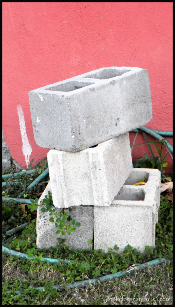stack cinderblocks pink wall white spot