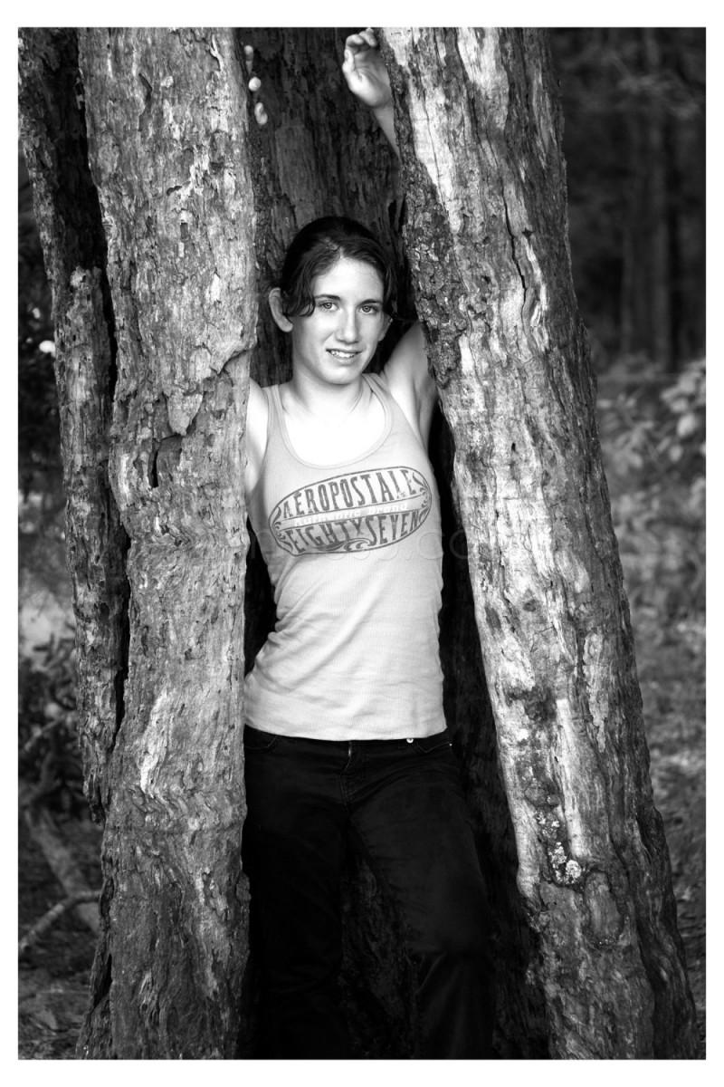 Female in hollow tree