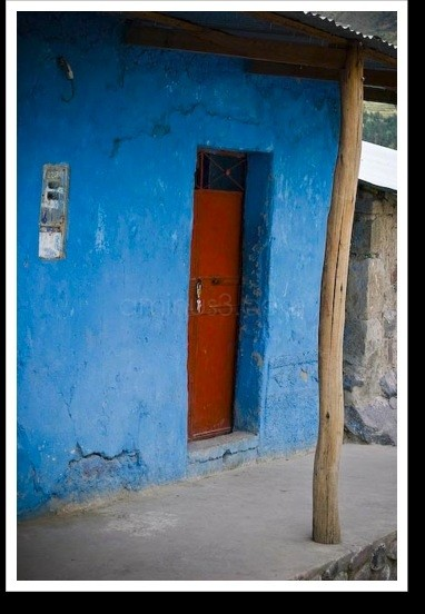 Blue house with a red door