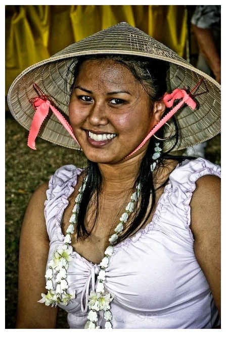 asian woman smiling with a hat