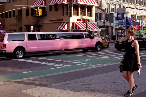 Pink stretch limo with inmates on Union Square