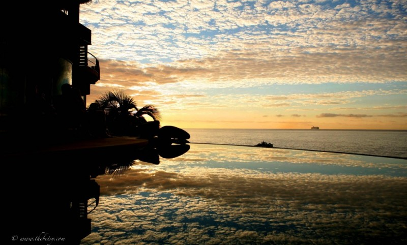cabo pool reflection sunrise infinity pool