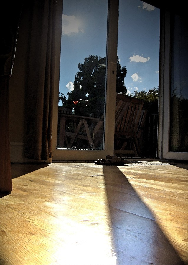 photo of sunlight through an open doorway