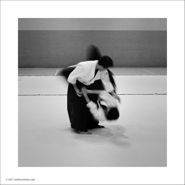 A b&w photo of Aikido showing the movement