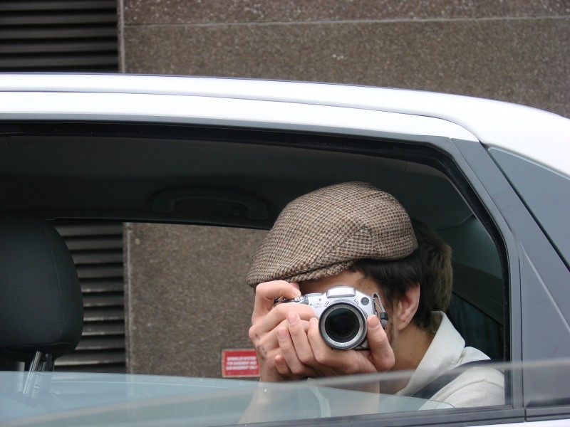 Photographer in car