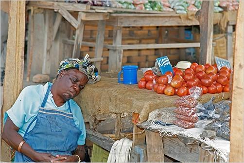 Sleeping market seller, Zambia Africa
