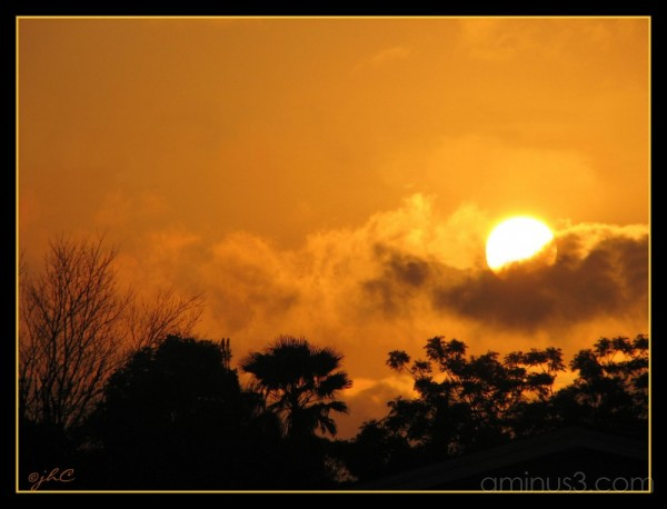 God cradling the sun...