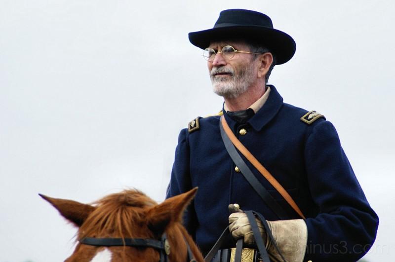 On horseback...
