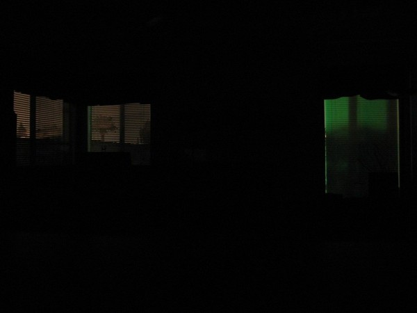 colored windows in living room with no lights