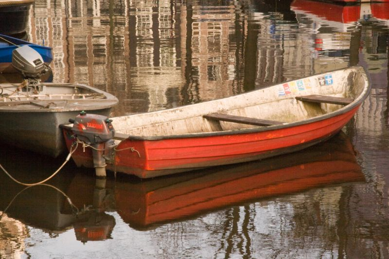 Little red boat in the city of Amsterdam