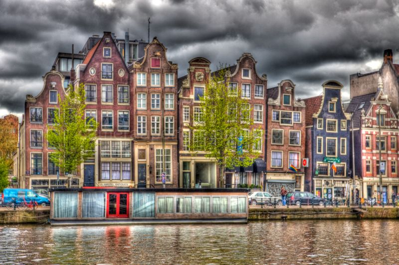 Amsterdam houses under a dark sky