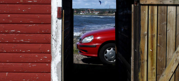 A red car and kitesurfing.