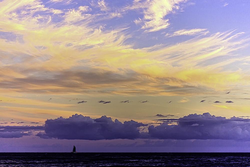 sailing beneath a pastel sky