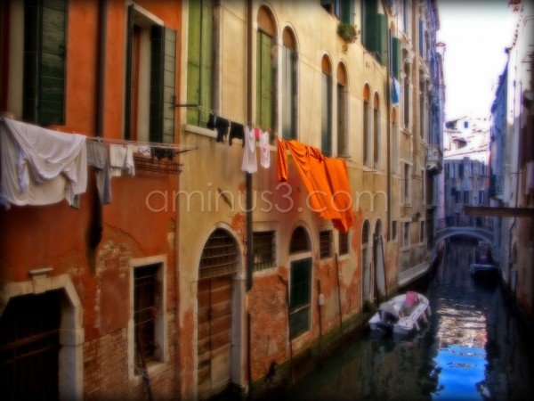 Canal in Venice with hanging laundry