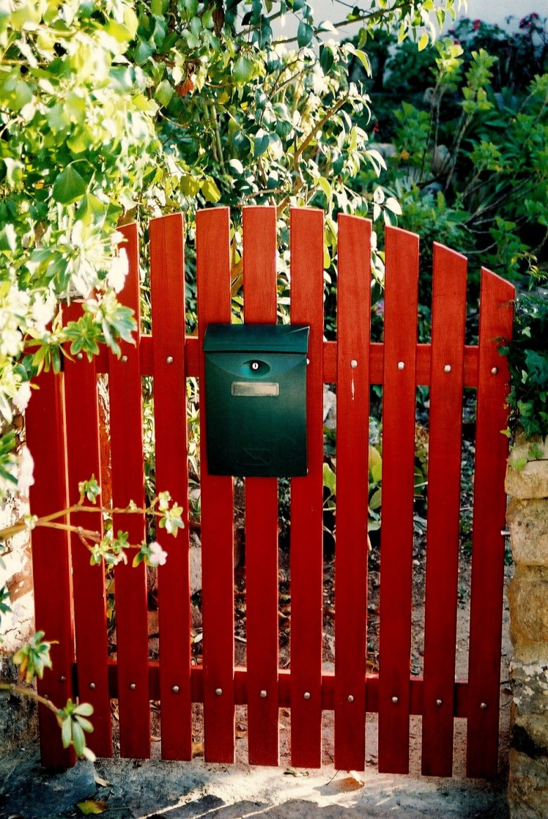 Red gate and letter box