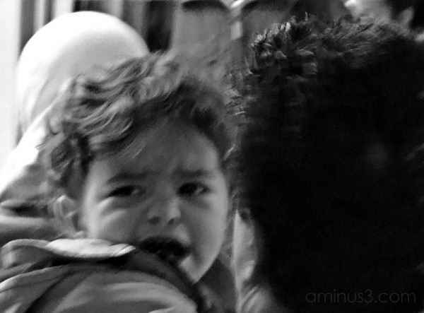 Crying child with his father.
