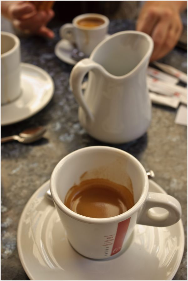 Coffee cups and saucers on a table.