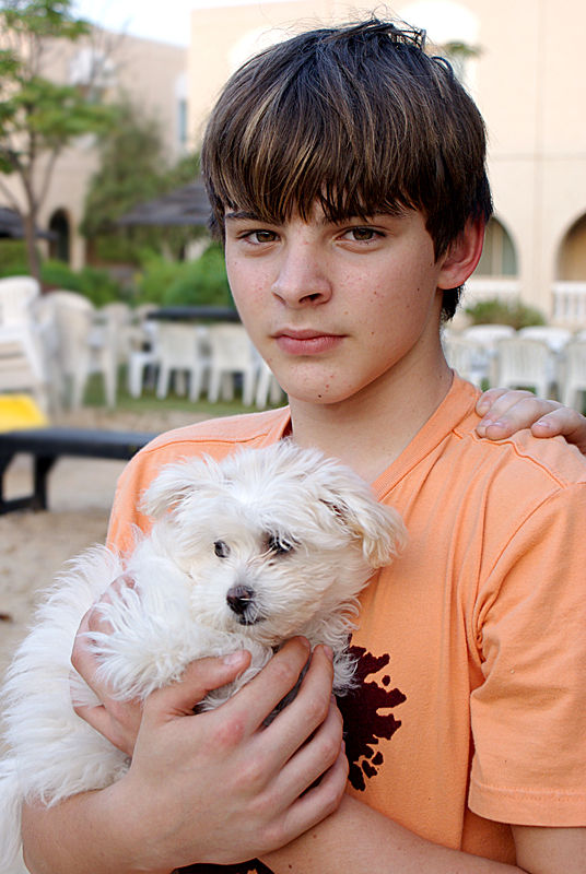 Young man with a puppy
