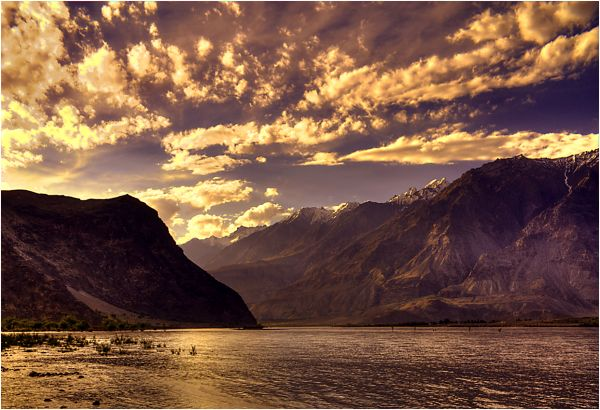 sunset over river indus