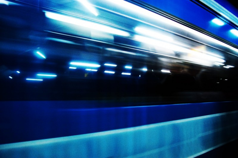 Human figure outlines as the train zooms by
