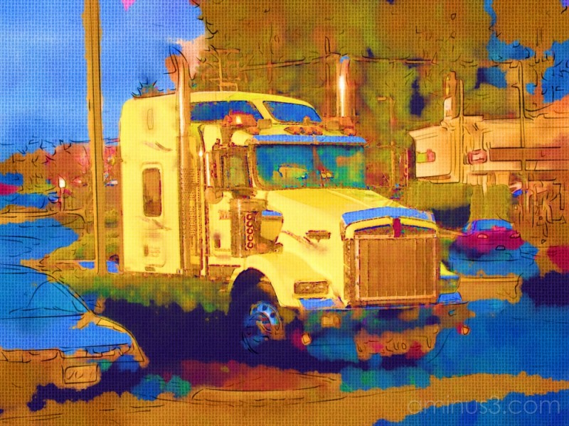 Yellow truck caught in the afternoon sun