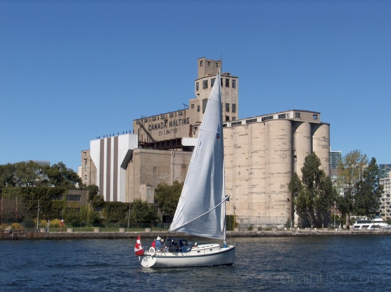 sailing in front of the Canadian Malting Co Ltd.