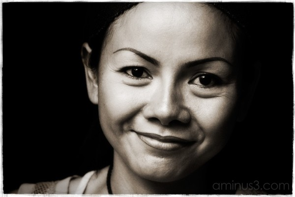 Black & white contrasted portrait.