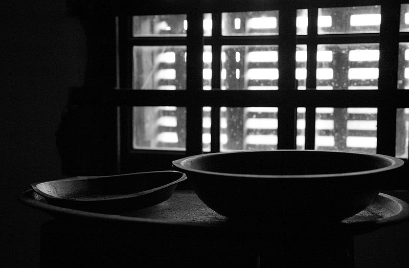 bowls in front of a jail cell window
