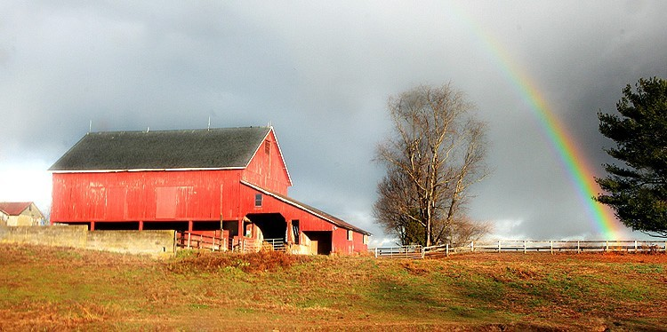 rainbow ends at a barn