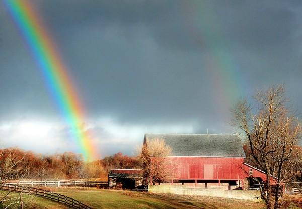 rainbow near a barn