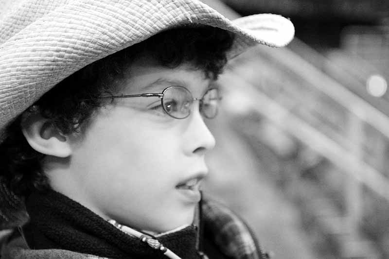 Profile of boy in cowboy hat