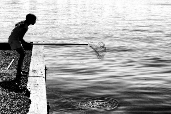 girl with net looking for crabs