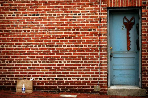 brick wall with locksmith sign