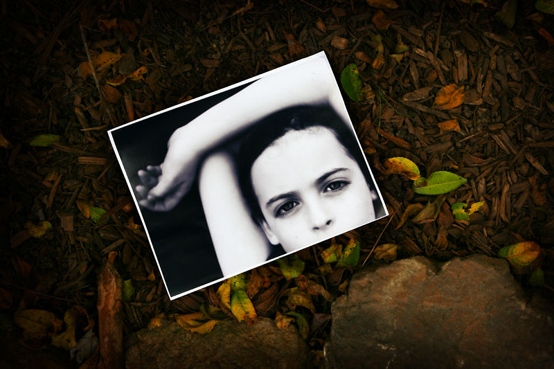 a portrait in a pile of mulch and leaves