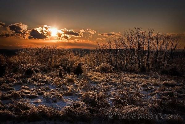 ice-covered sunset over pottstown, pennsylvania
