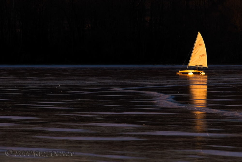 ice yacht on marsh creek lake at sunset