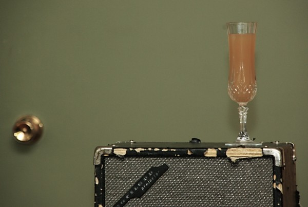 Champagne flute on speaker
