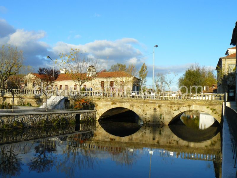 River Pavia (bridge and stone House)