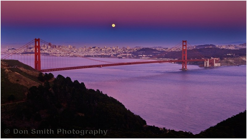 A summer solstice moon rises over San Francisco.