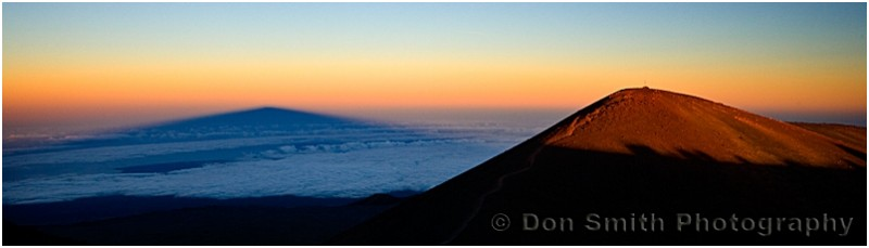 Hawaii's Mauna Kea cast a long shadow at sunset.