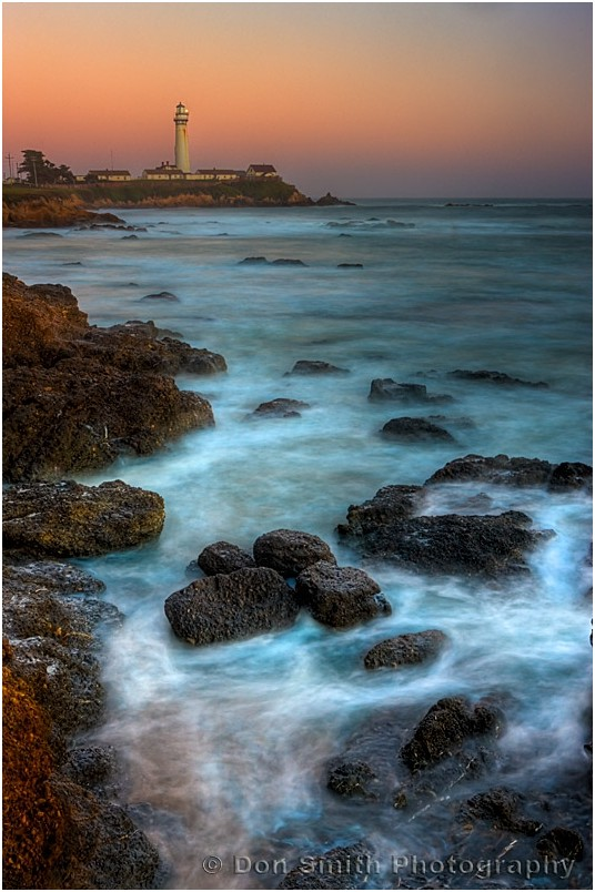 Pigeon Point Lighthouse against twilight sky.